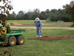 Photo: Bill Howe putting in the road base for Carolyn Balkum's siding.   2009-1127 HALS Anniversary Meet
