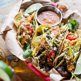 Bulgogi BBQ Pork Tacos with Charred Tomatillo Sesame Sauce + Spring Onion Slaw.