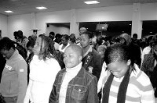 WORSHIP: Hundreds of youngsters in Daveyton celebrated June 16 by attending a youth rally held at the Oasis of Life Family Church, where speakers lectured them about taking their responsibilities seriously. Pic. Dan Fuphe. 17/06/2007. © Sowetan.