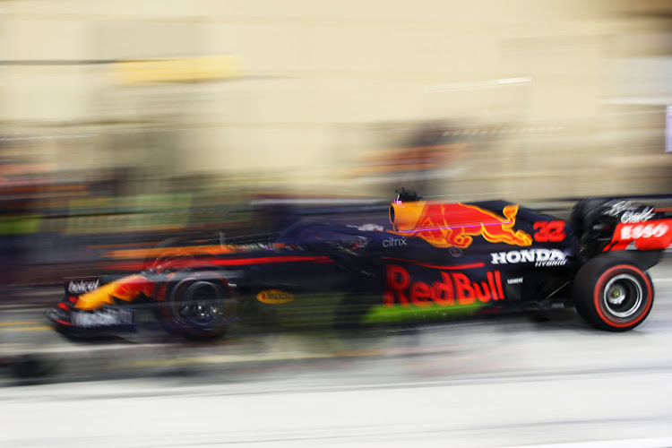 Max Verstappen of the Netherlands driving the Red Bull Racing Honda makes a pitstop during day three of F1 testing at Bahrain International Circuit on March 14 2021.