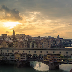 Florence by Filippo Arbinolo - Landscapes Sunsets & Sunrises ( clouds, water, famous, europe, exterior, sun, florence, nature, sunset, outdoors, popular, bridge, italy, river )