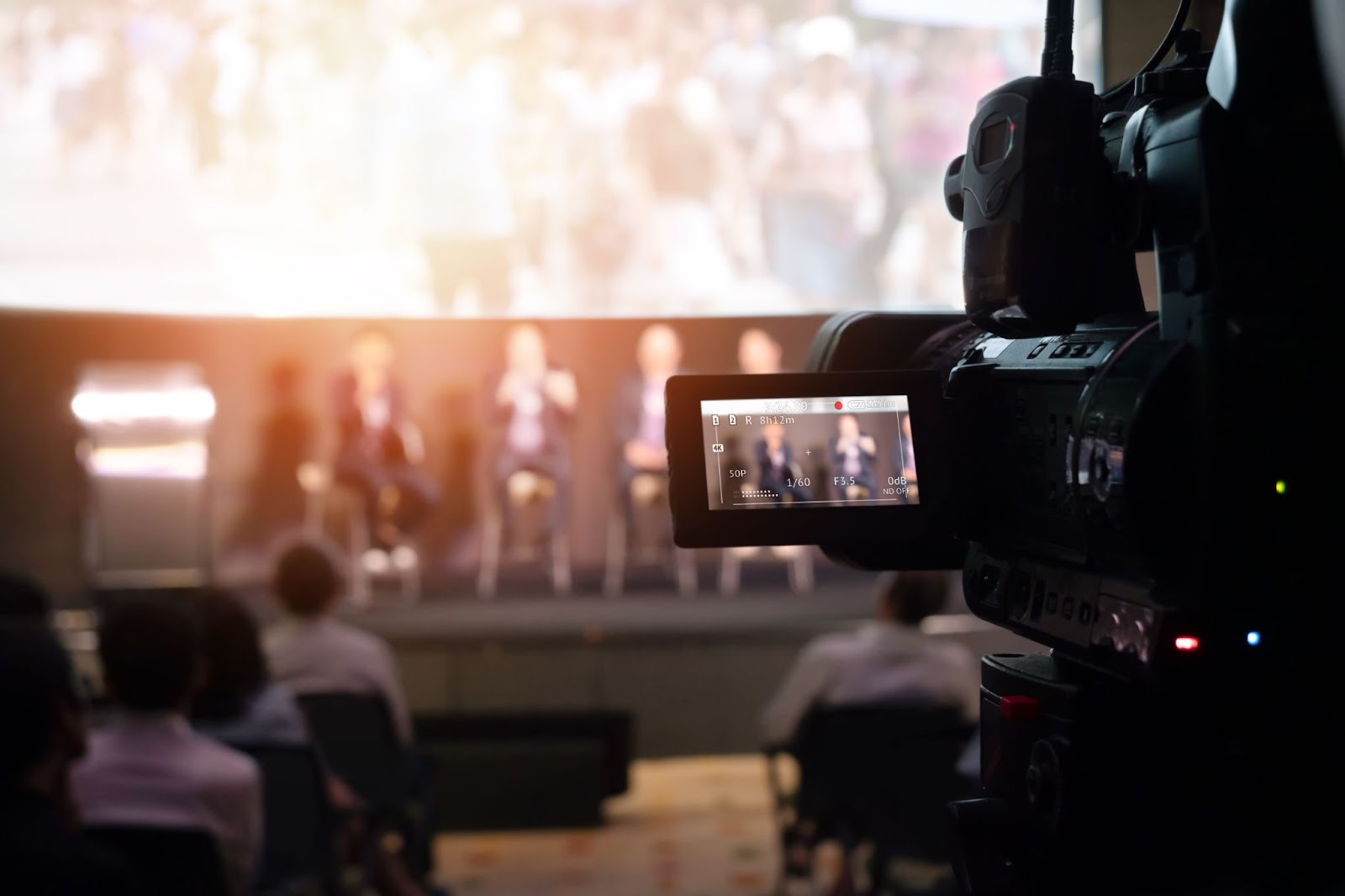 Pictured is a video camera filming a stage. This image is used to educate readers on how they can safely insure their rented gear through gear rental insurance.