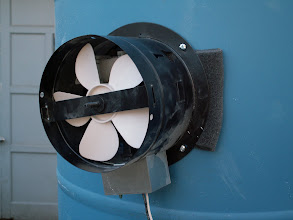 Photo: Exhaust fan attached to back of booth.