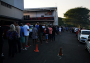 Voters wait at the Durban North Action Cricket Club voting station, where ballot papers ran out soon after the station opened.