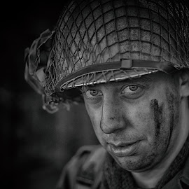 by Marco Bertamé - Black & White Portraits & People ( gi, american, helmat, eyes, army, potrait, soldier, headshot, military, looking, man, net, human, us )