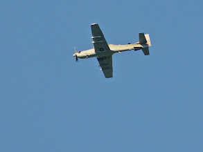 Photo: I saw a this 2-seat A-29 Super Tucano overhead yesterday. The local air base is using them to train Afghani pilots. I wonder if the US instructor in the rear seat is armed. http://www.af.mil/News/ArticleDisplay/tabid/223/Article/502897/a-29-super-tucano-arrives-at-moody-afb.aspx