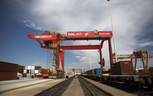 A loading crane straddles a freight rail track at Transnet's container handling terminal at City Deep inland port in Johannesburg. Picture: BLOOMBERG