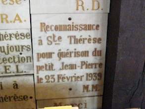 """Photo: There are many memorial plaques on the church walls, some quite touching, like this one: """"Gratitude to St. Theresa for curing little Jean-Pierre, February 23, 1939."""""""