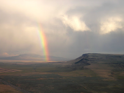 Rainbow over broad landscape.