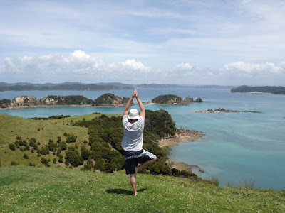Tree yoga pose near cliff in New Zealand - Photo by Jamie (Garrett) Moore