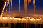 Glittering icicles light up a quiet snowy winter evening in  McCall, ID.