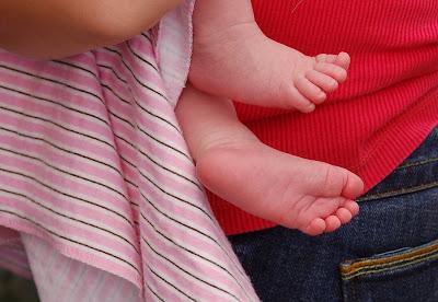 Tender pink baby feet.