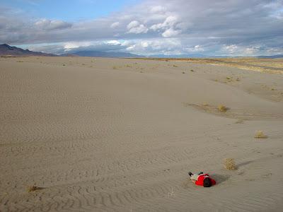 Watching the cloud drama - sand dunes, high desert near Winnemucca, NV.