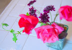 Found bouquet - bright pink roses, young geranium and something purple.