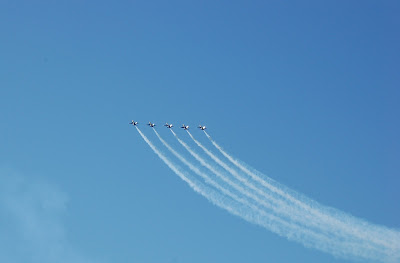 Blue Angels in formation, tails glinting in sun over San Francisco Bay. Photo by Lisa Callagher Onizuka