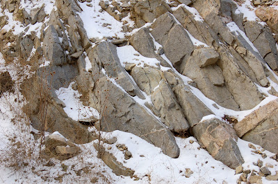 Winter rocks frosted in snow. Near Payette River, Idaho.