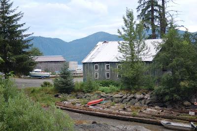 Canoe and boats near Herring Cove, Alaska.