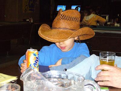 Little buckaroo with orange soda.