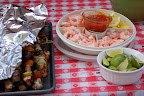 Delicious barbecue kabobs, limes and shrimp.