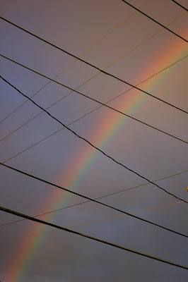Rainbow and power lines.