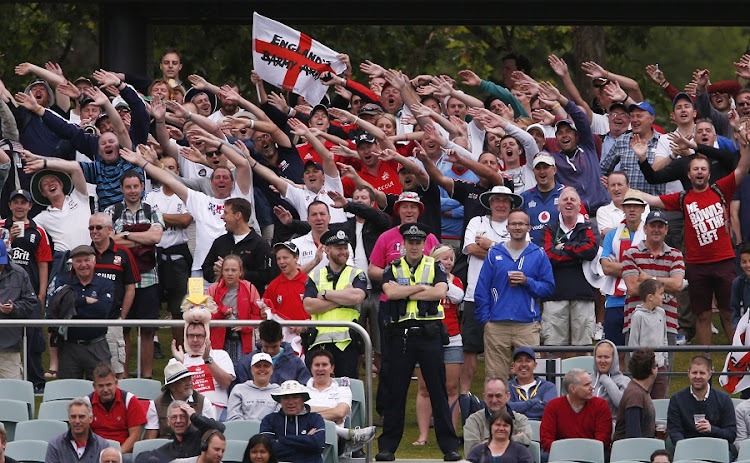 "England supporters from the ""Barmy Army"" fan organisation cheer during the fifth day's play in the second Ashes cricket test between England and Australia at the Adelaide Oval on December 9, 2013. File Picture: REUTERS/DAVID GRAY"