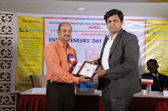Photo: Chief Guest Mr. A. Devi Dutt Issuing Young Entrepreneur Award to Mr. Bharath Rajanna, Founder & CEO, Eduprime India, Bangalore, Karnataka