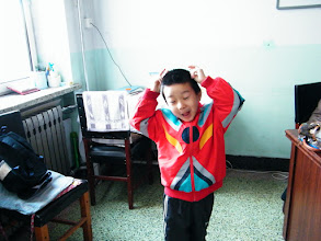 Photo: emakingir's works: baby son, warrenzh, owner of warozhu.com and wozon.net, in his mom's school's medicine room, where her befriending colleague works here.