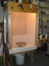 Photo: I have wanted to build a waterfall style spray booth for a long time.  I saw my first one at the Red Star Studios in Kansas City that Jesse Hull had built.  Recently someone posted a link to Tom Turner's design (shown above) on his web site.  The unique feature of Tom's design is the use of a three piece shower stall as the framework for the booth.  I went to my local building supply store to start Tom's version of the project and discovered two things.  The first was the cost of a shower stall was about $350.  I'm cheap and that seemed like a lot of money just to start the project.  The second was the size.  It was much larger than I expected and bigger than I needed.  I asked the salesperson if they had any seconds.  He said they didn't but if I wanted to make a less expensive, smaller version I should just get a 50 gallon plastic drum from the wholesale food supplier down the street.  So for $15 I got started.