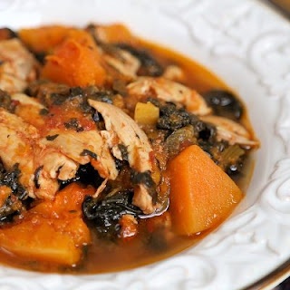 Whole 30 Slow Cooker Chicken Thighs with Butternut Squash and Spinach.