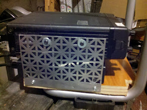 Photo: I used a piece of metal screen to secure the radios.