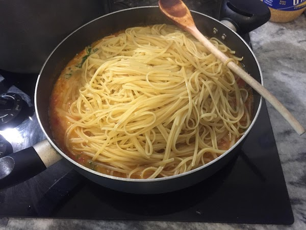 Add pasta to the sauce and toss to coat