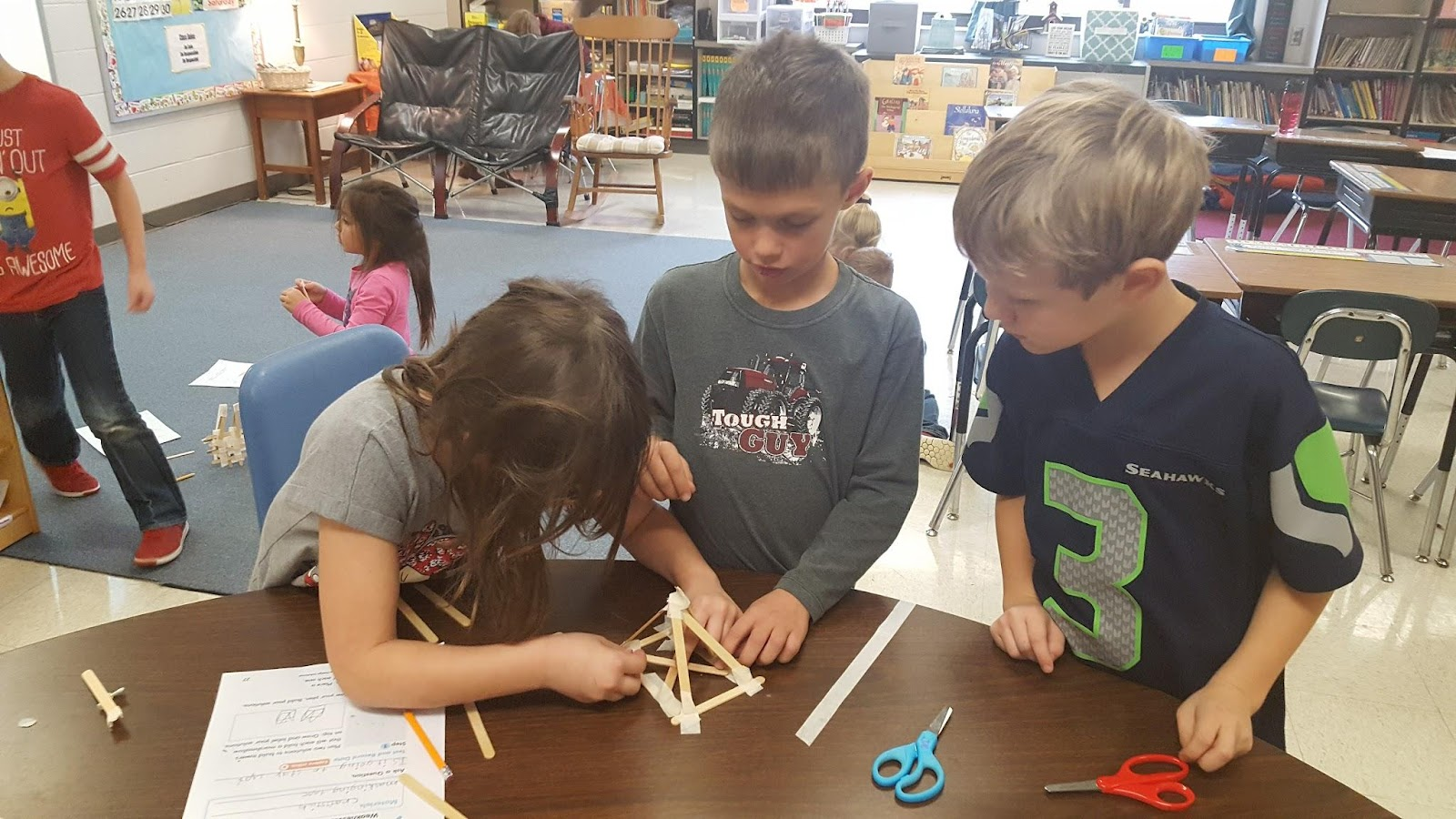 Students building craft tower