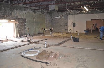 Photo: Hot/Cold/Drain lines are in.  Concrete being poured as this photo was taken.