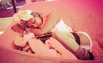 Photo: A girl has fallen asleep on the couch at the Pink Heart camp...