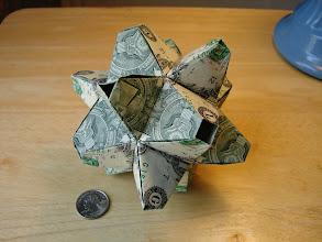 Photo: Model: 24-Unit Cuboctahedron;  Creator: Tomoko Fuse;  Folder: William Sattler;  24 dollars total, no glue, the modules fit together using a tab-in-pocket method;  Publication: Unit Polyhedron Origami ISBN 4-88996-205-0