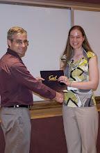 Photo: Kristen Woyach accepting the Samuel Silver Memorial Scholarship Award.