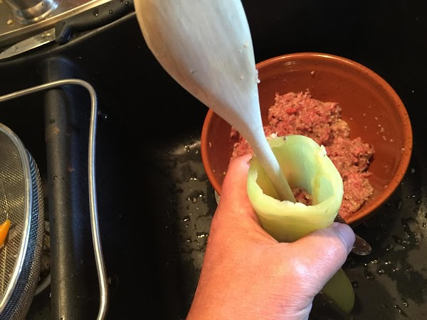 Carefully stuff meat mixture a teaspoon at a time and gently shove down with...