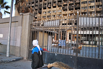 Photo: A burnt out government building still bears the scars of last year's uprising.
