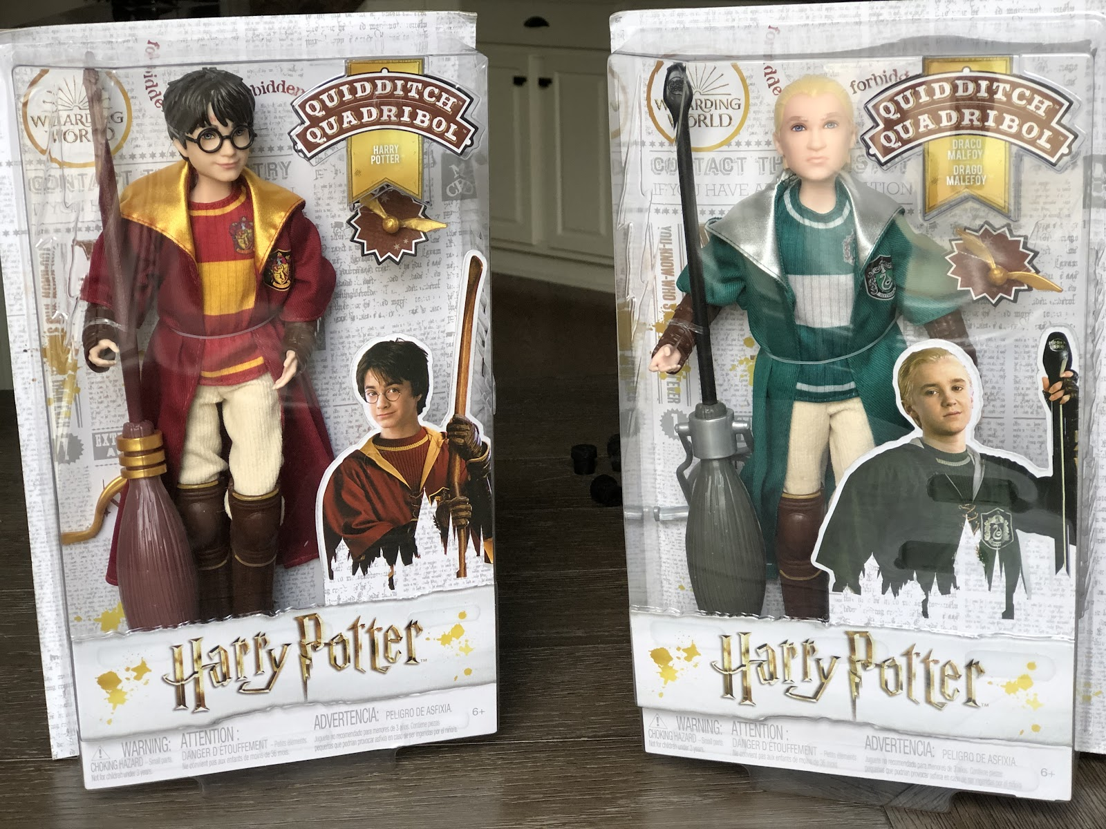 Two see through boxes with Harry Potter action figures in them.