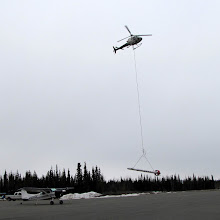 Photo: The device slung from the helicopter is used in mining to detect prospective mining sites. It contains some kind of electronics. It is not a missile