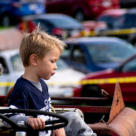 by Vicki Switala Riley - Babies & Children Children Candids ( expression, rural, blue shirt, watching, boy, vineyard, child portrait, son, outdoors, balloon festival, fall, outside, tractor, children candids, autumn, vintage tractor, sitting, landscape, male,  )