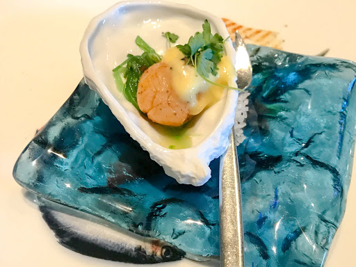 A seared scallop pre-appetizer served at Sur la Mer on ms Oosterdam.
