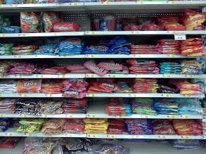 Photo: Ok now onto grabbing things for our movie. A stop in the candy section is a must. Skittles, check!