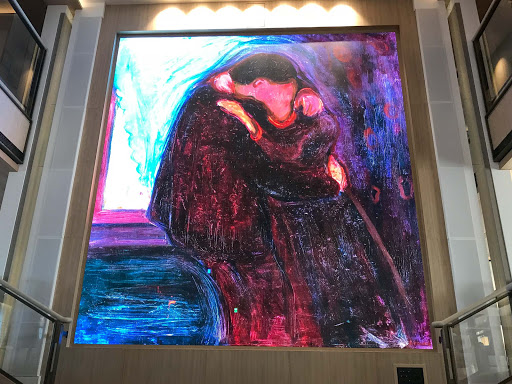munch-artwork-in-atrium.jpg - Artworks by Edvard Munch and other Scandinavian artists are displayed on the digital screen in the atrium of Viking Sun.