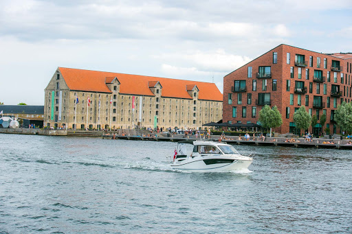 copenhagen-christianshavn.jpg - A tour boat slices through the canal separating the Christianshavn and Nyhavn districts.