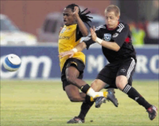 STOP! Kaizer Chiefs' Siphiwe Tshabalala is fouled by Orlando Pirates' Michael Morton during the final of the Telkom Charity Cup at Mmabatho Stadium in Mafikeng on Saturday. Pirates won 1-0. Pic. Antonio Muchave. 02/08/08. © Sowetan.