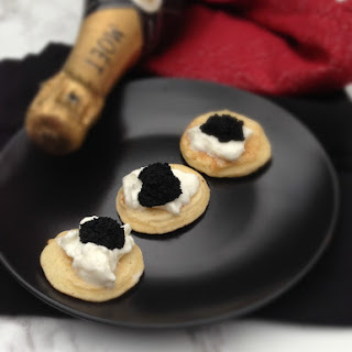 Caviar and Blini With Champagne.
