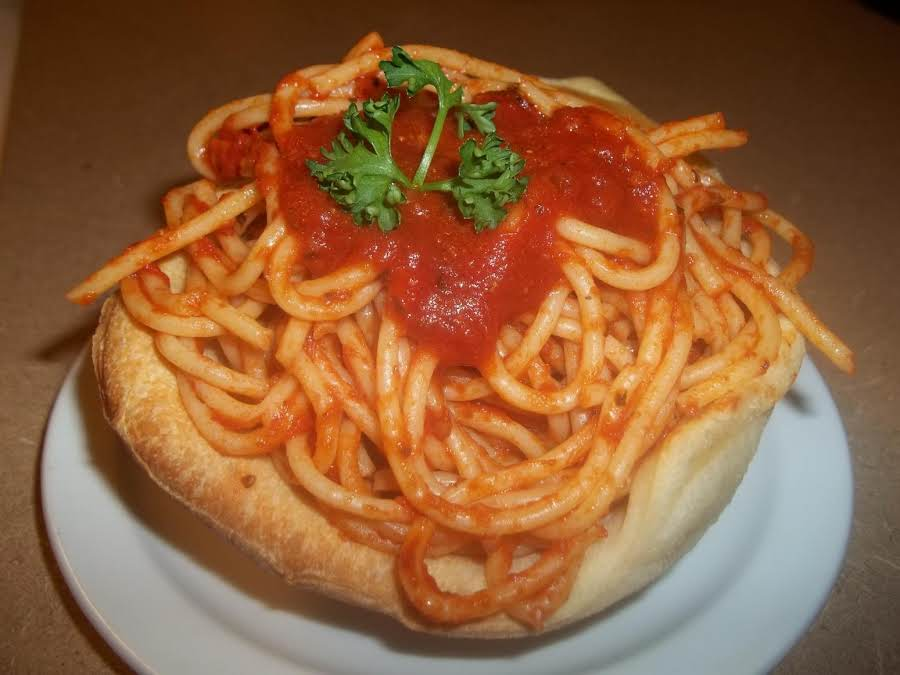 Spaghetti Filled Bread Bowls Recipe Just A Pinch Recipes