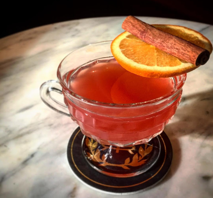 Cinnamon Campari Sidecar with Calvados apple brandy, Campari, apple cider, cinnamon, lemon and orange.