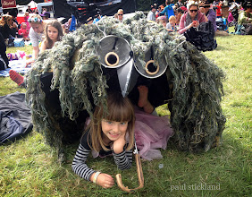 Photo: The Owlbrella This years must-have festival accessory! We all dressed up as owls, foxes, frogs, fish, stags and lions at Just So Kid's Festival.  I made this owl costume out of Arthur's ghillie suit, a couple of sieves and some curtain rings, put it on and it was way too scary, so he morphed into an owlbrella! Here sheltering Tabitha as we waited for the wonderful John Hegley, who was absolutely hilarious.  #kids   #festivals #owls   #justsofestival